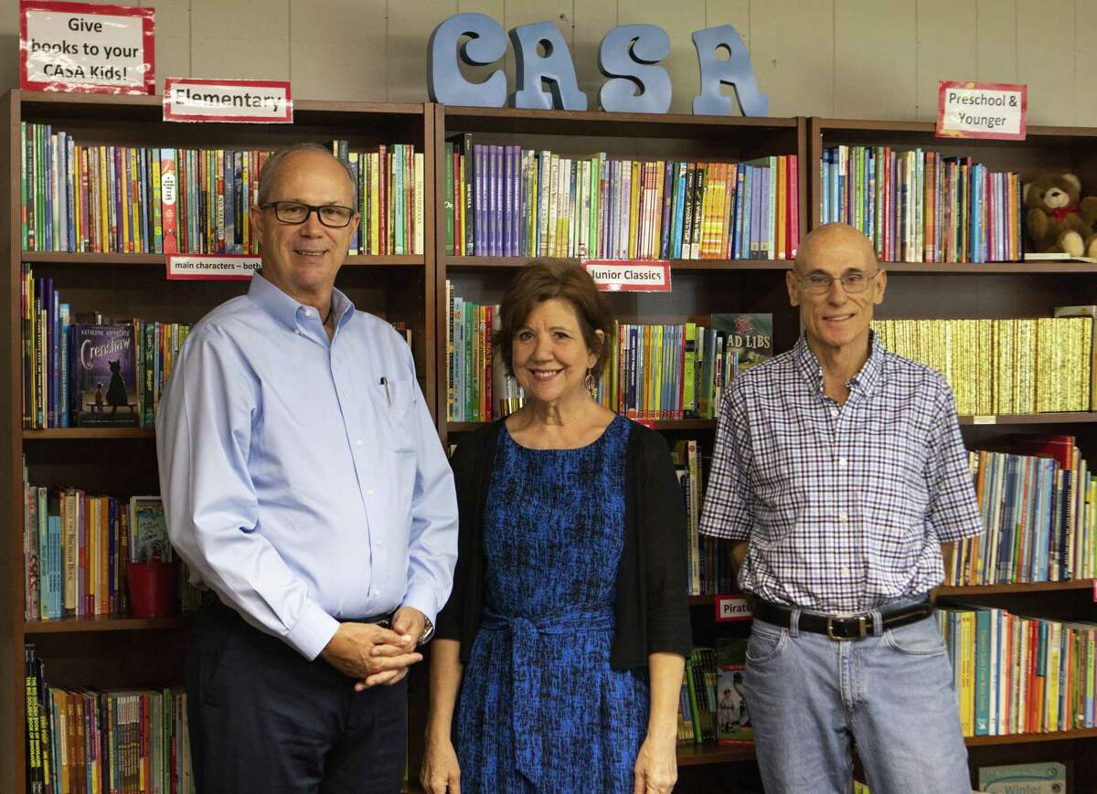 From left, Casa volunteer Mike Driscoll, CASA executive director Ann McAlpin and CASA volunteer Ron Finch work together at the Court Appointed Special Advocates for children in Montgomery County. CASA in Montgomery County is looking for more male volunteers to connect with young men whose parents are going through the court system.