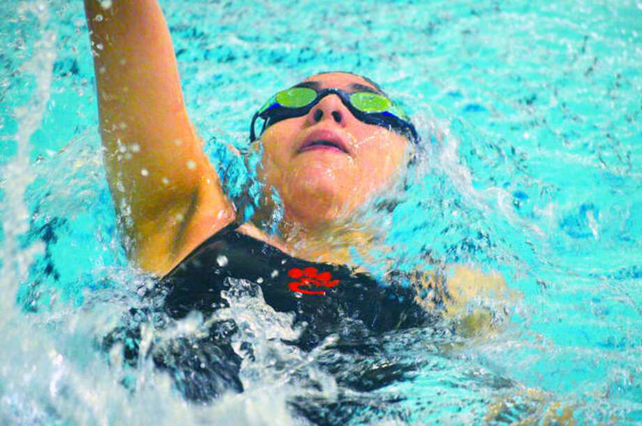 Edwardsville's Ximena Gonzalez swims in the 100-yard backstroke during Thursday's dual meet against Chatham Glenwood at Chuck Fruit Aquatic Center.