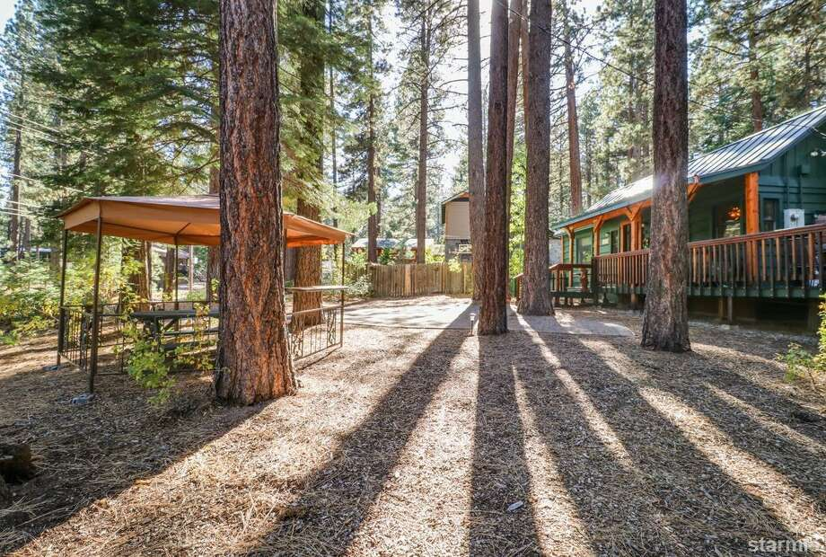 Vacation in Tahoe doesn't have to be so pricey-- this 1950s cabin is $375K and you can also snap up the lot next door for another $60K Photo: Dan Thrift