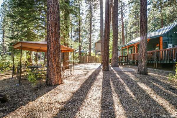 Vacation in Tahoe doesn't have to be so pricey-- this 1950s cabin is $375K and you can also snap up the lot next door for another $60K