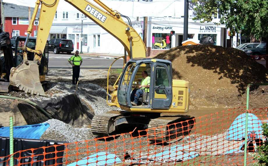 Work to improve drainage downtown is underway at Sherman Green. Photo: Genevieve Reilly / Hearst Connecticut Media / Fairfield Citizen