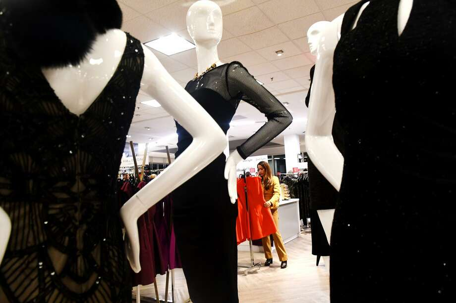 Rosemarie DePasquale eyes a red dress in the newly renovated Lord & Taylor Stamford store in 2016. Photo: Hearst Connecticut Media File Photo / Greenwich Time Freelance
