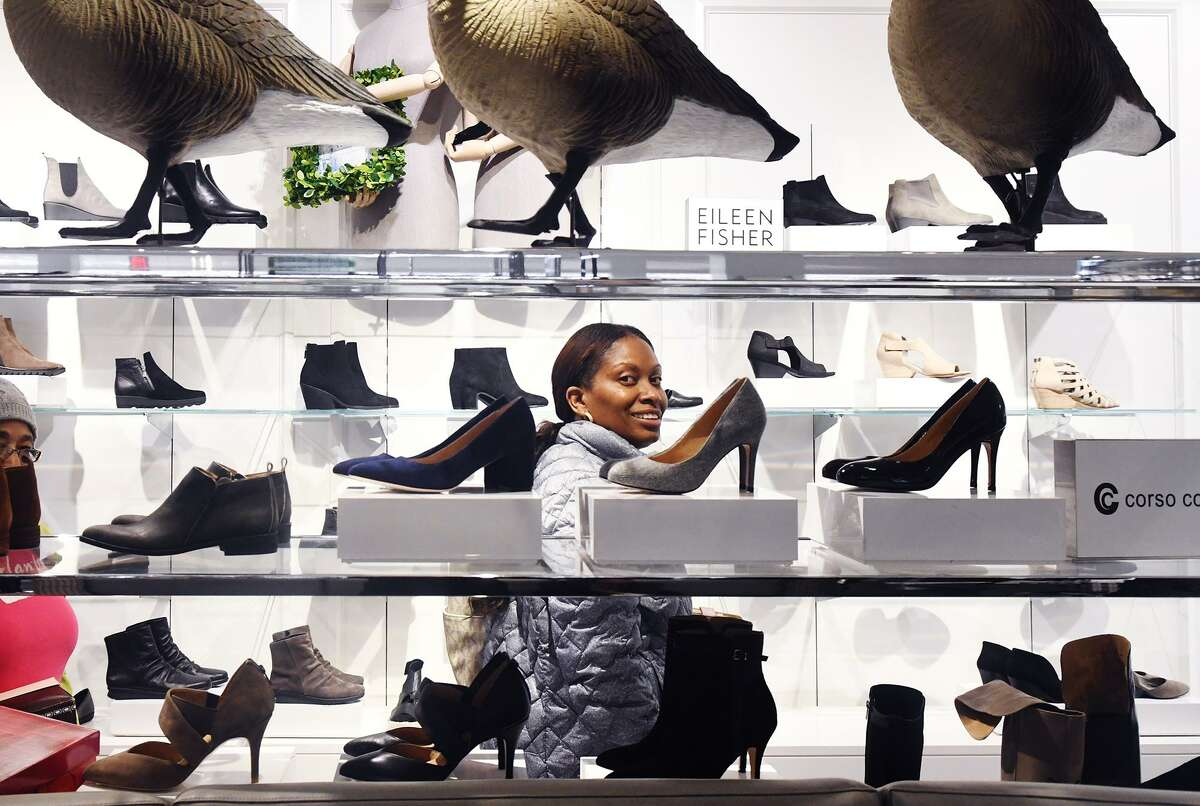 FILE - Yvonne Desport peruses the shoes as Lord & Taylor celebrates the launch of its newly renovated store in Stamford, Conn., Dec. 1, 2016.