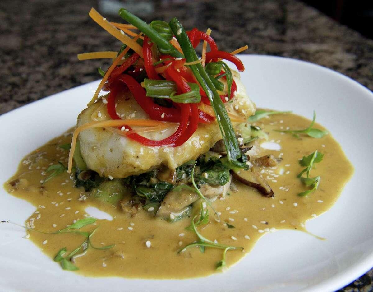 Pan roasted halibut with lemongrass ginger beurre blanc, baby bok choy and shitake mushrooms at Olio.