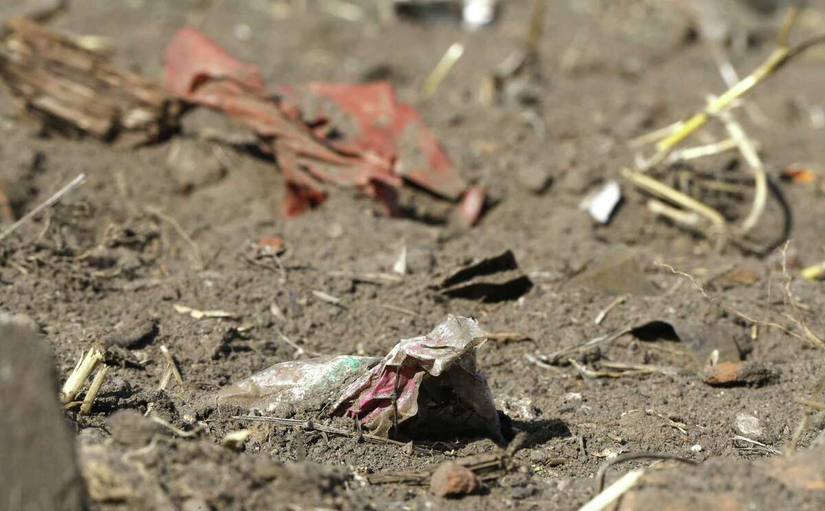 Plastic waste sits on a freshly cultivated field in Nauen, Germany, Sunday, Sept. 9, 2018.