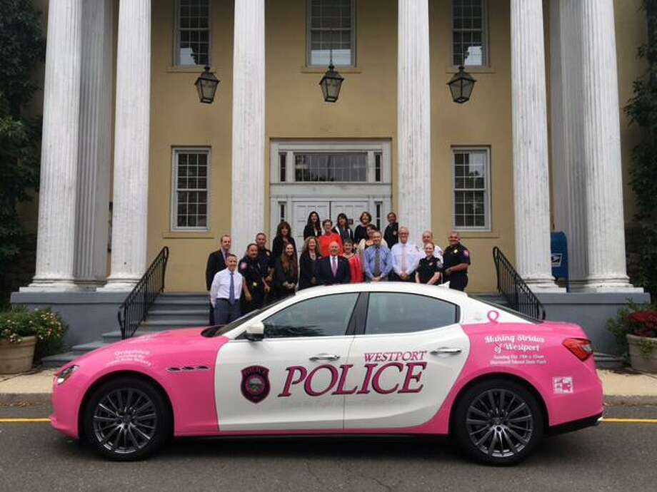 The Westport Police Department unveiled a pink police decal vehicle on Oct. 1 in recognition of Breast Cancer Awareness Month. The vehicle has been donated to the department for the month of October. Photo: Contributed Photo