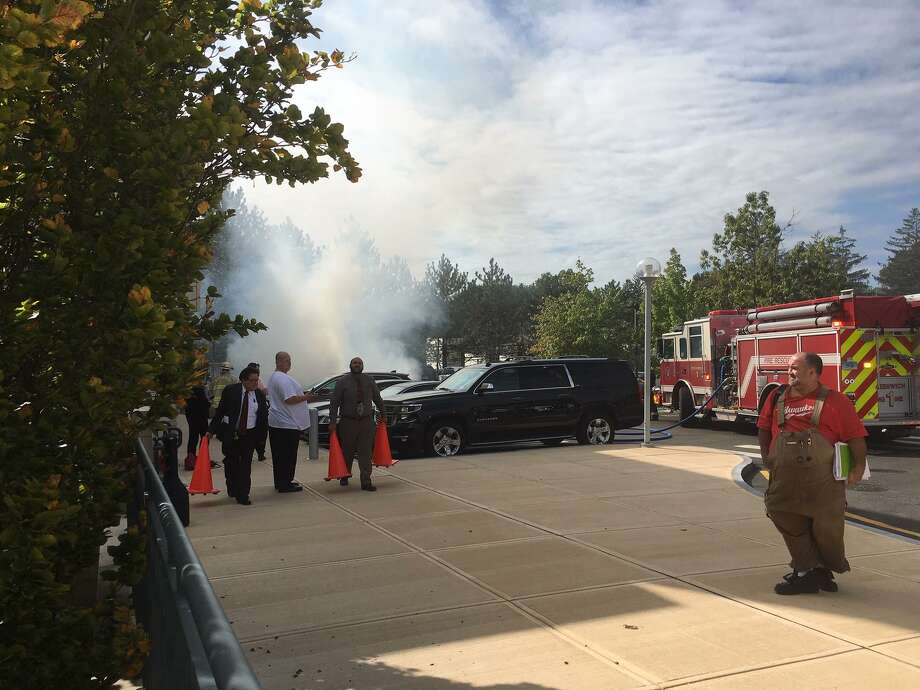 A car fire brought firefighters to the Greenwich Library Friday afternoon. Photo: / Hearst Media