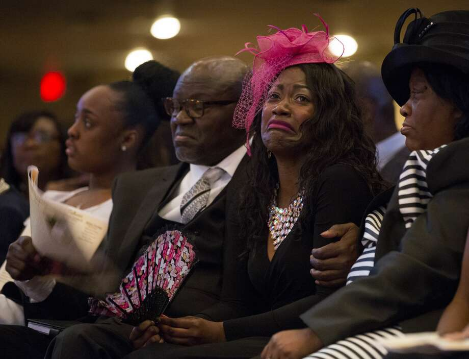 PHOTOS: Family devastated Roxane Freeman, center, grieves the loss of her husband, Heywood, and children, Halynn and Haywood Jr., during the funeral service at the Greater Grace Outreach Church. >>>See more images of the wreck's impact on a Houston family ... Photo: Godofredo A. Vasquez/Staff Photographer