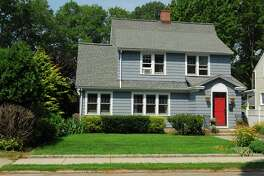 The gray colonial house at 142 Oldfield Road is located in Fairfield Center, an easy walk to the train station, shopping, restaurants, recreational venues, and many other town amenities.