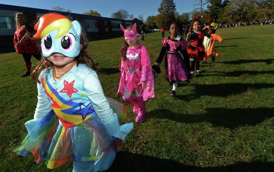 FILE PHOTO — Kindergartner Charlotte Maldonado marches with her class as Brookside Elementary School holds their annual Halloween Parade Tuesday, October 31, 2017, outside the school in Norwallk, Conn. Photo: Erik Trautmann / Hearst Connecticut Media / Norwalk Hour