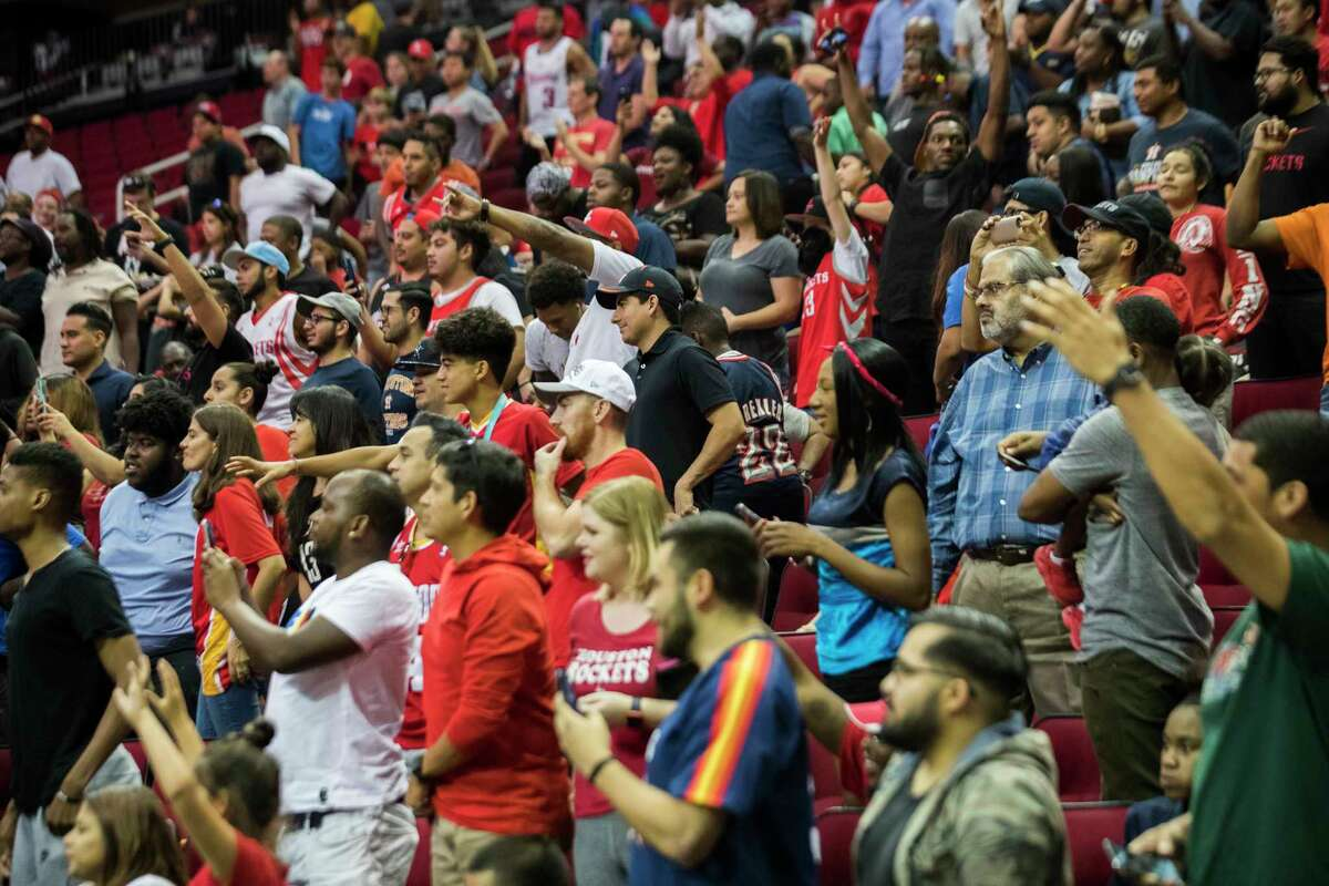 Fans cheer and listen to some Houston Rockets players sing for them during the Fan Fest & Open Practice, Friday, Oct. 5, 2018, in Houston.