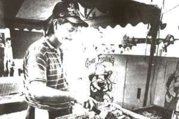 Jeff Brannen cooks up some cajun catfish during the first Conroe Cajun Catfish Festival in 1990.