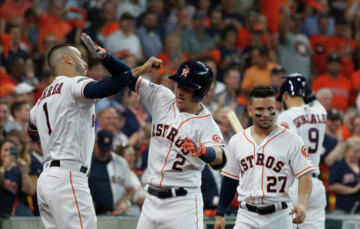 Houston Astros third baseman Alex Bregman (2) celebrates a home run with Houston Astros shortstop Carlos Correa (1) in the fourth inning of Game 1 of the American League Division Series at Minute Maid Park on Friday, Oct. 5, 2018, in Houston.
