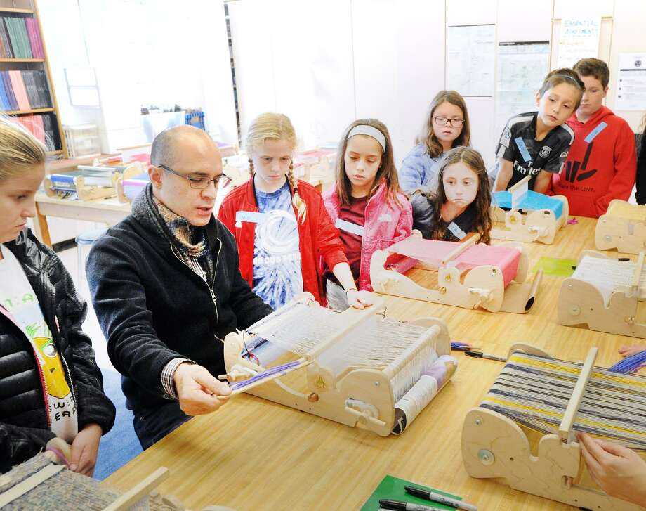 Ruben Marroquin of Bridgeport, teaches weaving to fourth-grade students at the Cos Cob School in Greenwich, Conn., Friday, Oct. 5, 2018. Marroquin, a weaver who studied at F.I.T., has roots in both Guatemala and Venezuela, visited the school as part of an interdisciplinary weaving and Spanish workshop that was part of National Hispanic Heritage Month. Photo: Bob Luckey Jr. / Hearst Connecticut Media / Greenwich Time