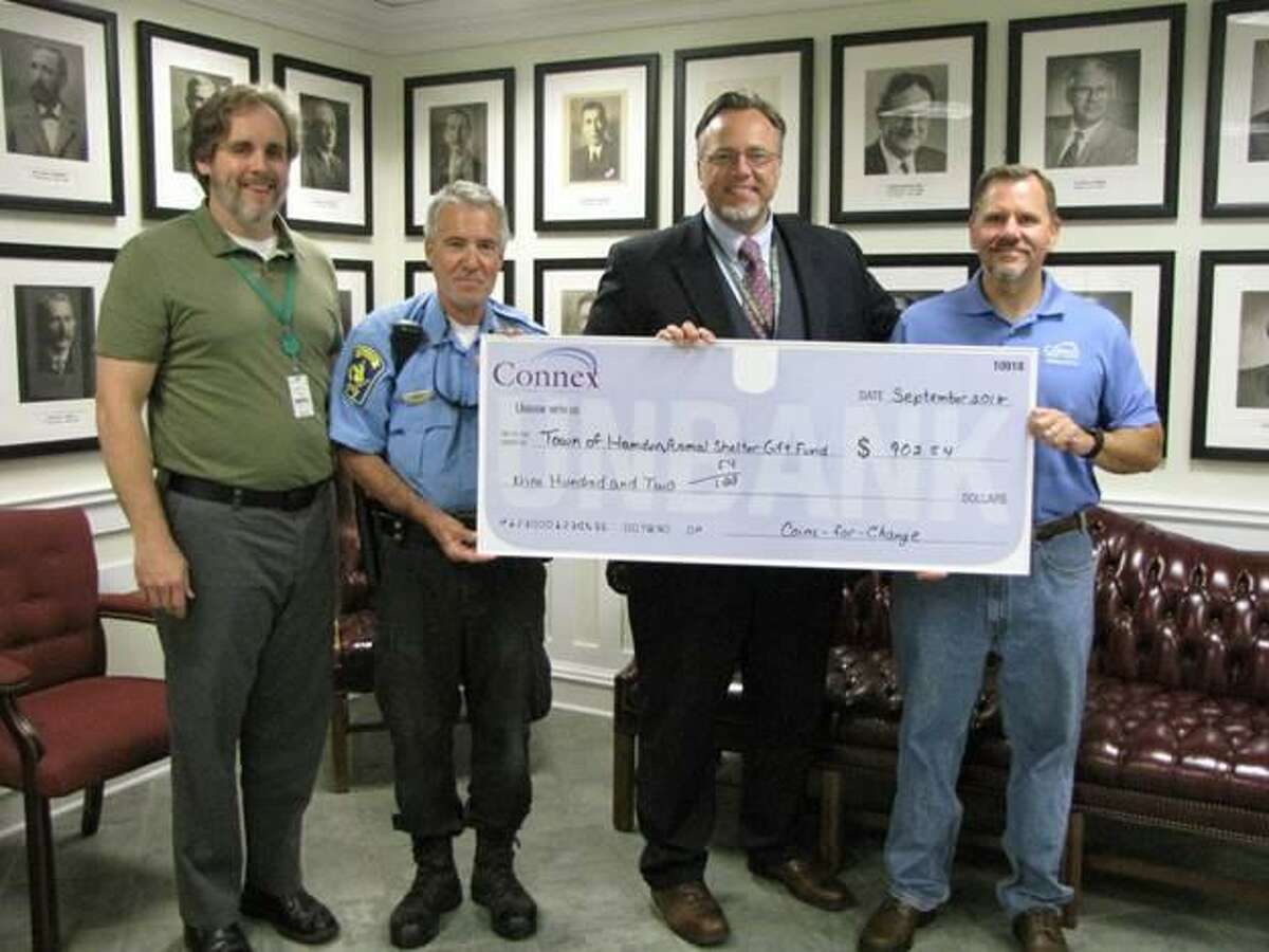 From left, Chief of Staff David Garretson, Animal Control Officer Chris Smith, Hamden Mayor Curt Leng, and Carl Casper, executive vice president and chief operating officer, Connex Credit Union