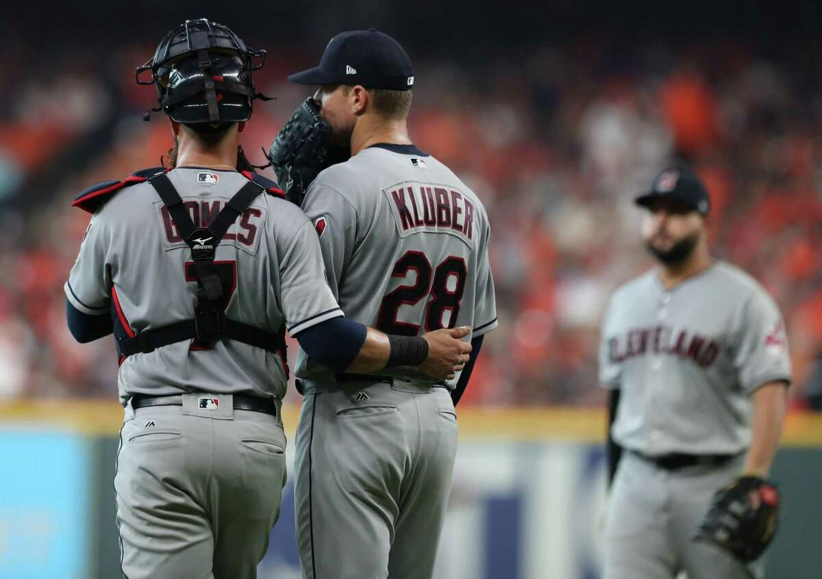 Cleveland Indians catcher Yan Gomes (7) checks in with Cleveland Indians pitcher Corey Kluber (28) on the mound in the fourth inning of Game 1 of the American League Division Series at Minute Maid Park on Friday, Oct. 5, 2018, in Houston.
