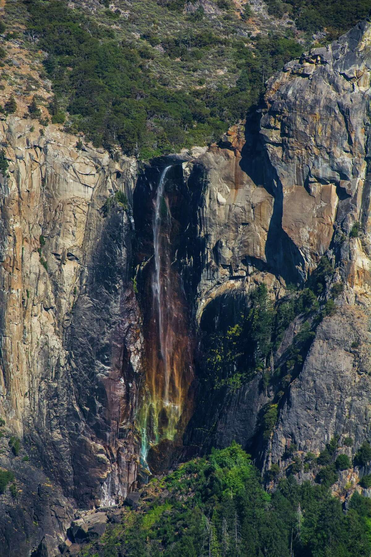 """""""In spring and fall, as the sun lowers its position on the horizon, late afternoon sunlight turns Bridalveil Fall into a rainbow,"""" Yosemite National Park reports."""