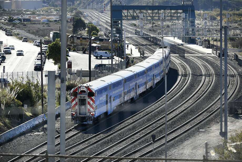 A northbound Caltrain makes its way past the Bayshore Caltrain Station in Brisbane, Calif., on Thursday, Dec. 21, 2017. Caltrain tweeted several updates Wednesday morning about delays for trains coming out of San Jose, with hold-ups up to 35 minutes at some stations. Photo: Michael Short / Special To The Chronicle