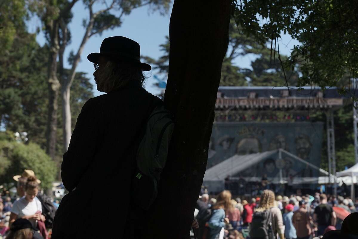 A man watches as the David Bromberg Quintet performs at Hardly Strictly Bluegrass in San Francisco, Calif. on Friday, Oct. 5, 2018