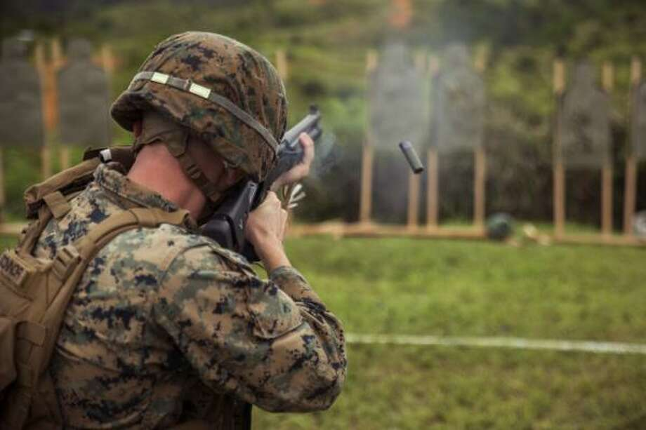 Torrington native Lance Cpl. John O'Connor fires an M1014 shotgun during a shotgun tactical proficiency range at Camp Hansen, Okinawa, Japan, Sept. 25. Photo: U.S. Marine Corps, Pfc. Mark Fike / Contributed Photo /