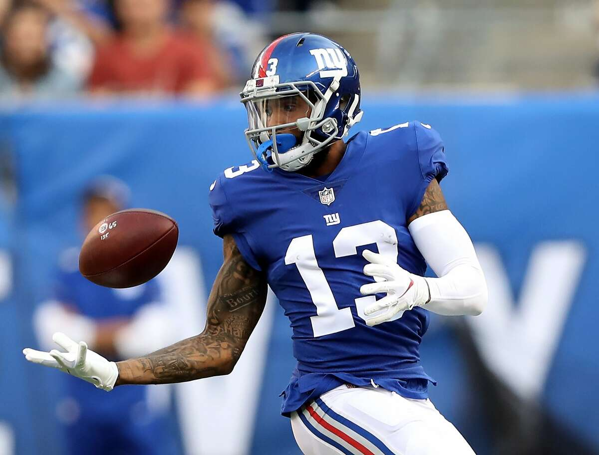 Odell Beckham #13 of the New York Giants bobbles a the ball but makes the catch in the second half against the New Orleans Saints on September 30,2018 at MetLife Stadium in East Rutherford, New Jersey. (Photo by Elsa/Getty Images)