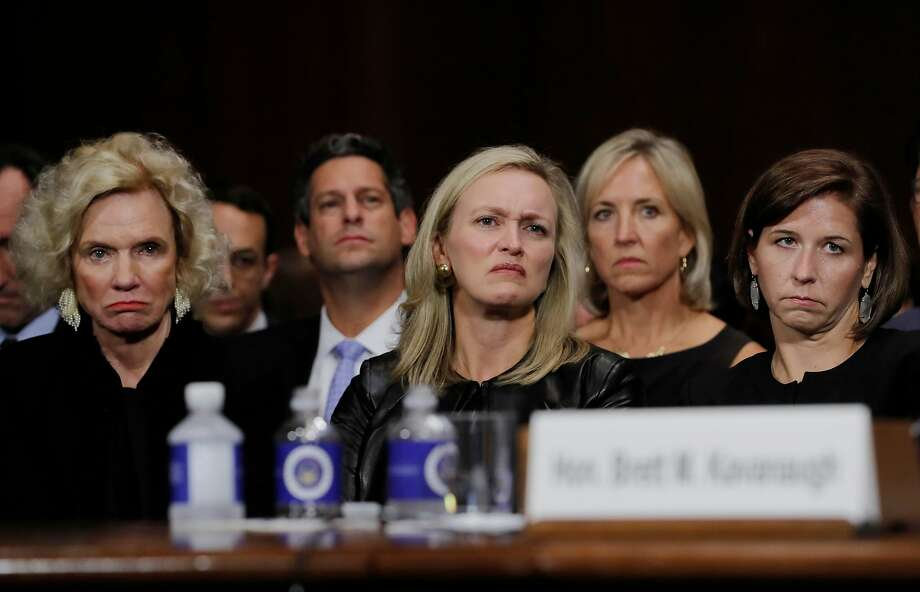 Joel Kaplan (center left), Facebook's vice president for global public policy, sits with friends and family of Brett Kavanaugh. Photo: Jim Bourg / New York Times