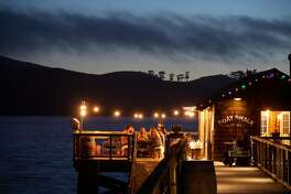 West Marin makers gather for dinner at the boat house at Nick�s Cove on Tomales Bay on Thursday, Sept. 13, 2018 in Marshall, CA. The makers all know each other and contributed something from their craft to the meal.