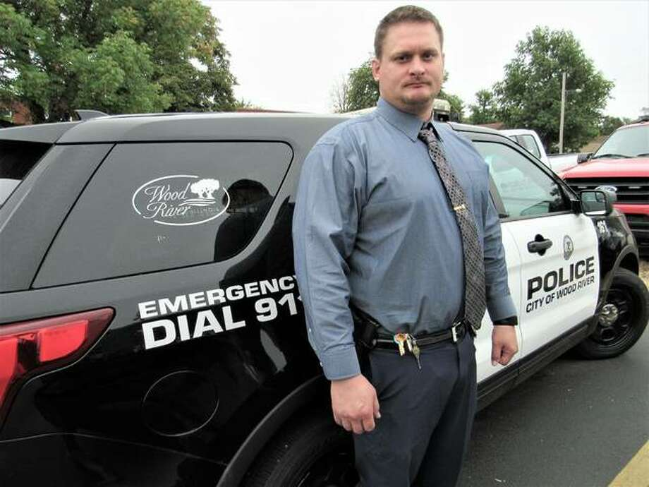 Newly-hired patrolman Aaron Burns was sworn in at Monday's City Council meeting, joining Wood River Police Department mainly because of the specialized areas of work the department offers, through a lateral transfer policy allowing departments to increase their skill base and diversity, as police academies become crowded, time consuming and expensive for cities. Photo: Brittany Johnson | The Telegraph