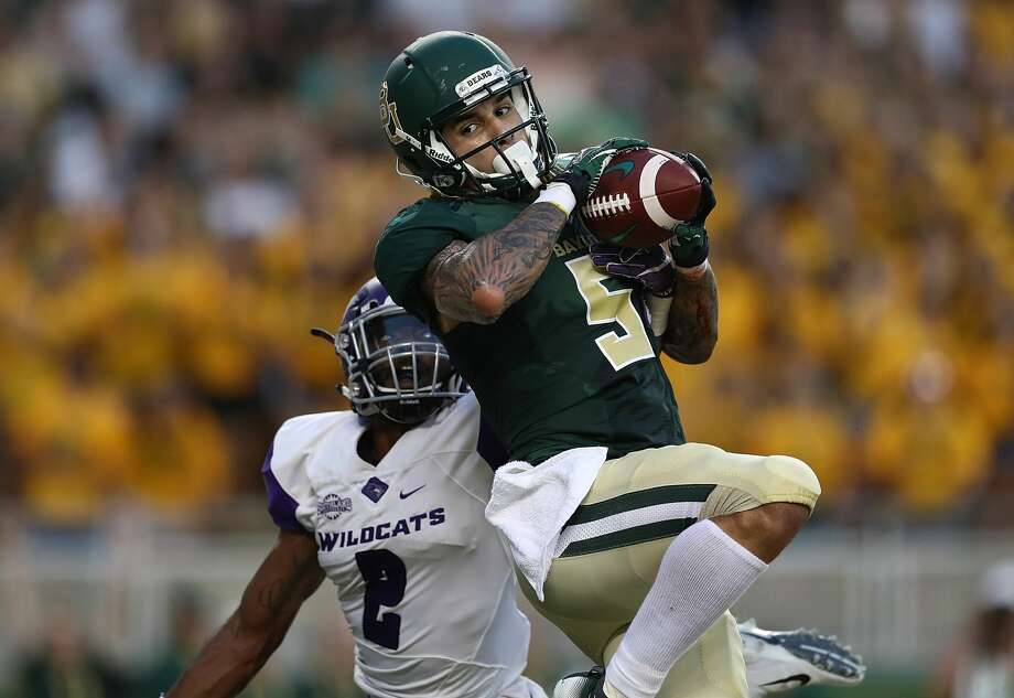 WACO, TX - SEPTEMBER 01:  Jalen Hurd #5 of the Baylor Bears makes a touchdown pass reception against Brandon Richmond #2 of the Abilene Christian Wildcats at McLane Stadium on September 1, 2018 in Waco, Texas.  (Photo by Ronald Martinez/Getty Images) Photo: Ronald Martinez/Getty Images