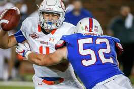 Houston Baptist quarterback Bailey Zappe (4) is sacked by Southern Methodist defensive end Gerrit Choate (52) during the first half on Saturday, Sept. 29, 2018, at Ford Stadium in Dallas.