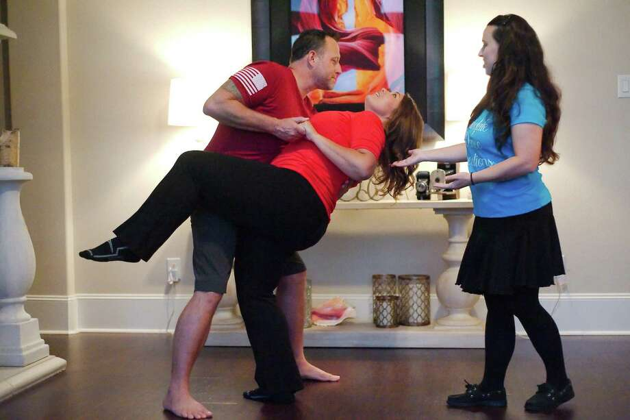 Scott Pena and his bride-to-be Lacy Dagerath enjoy a dance lesson from event choreographer Stephanie Hendrickson. Photo: Kirk Sides / Houston Chronicle / © 2018 Kirk Sides / Houston Chronicle