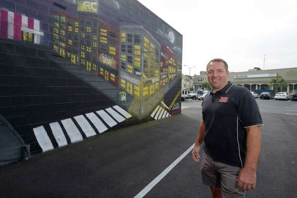 Realty businessman Jason Milligan had a mural painted on the side of one of his Isaacs Street buildings by the artist known as Action Thursday, October 4, 2018, in Norwalk, Conn.