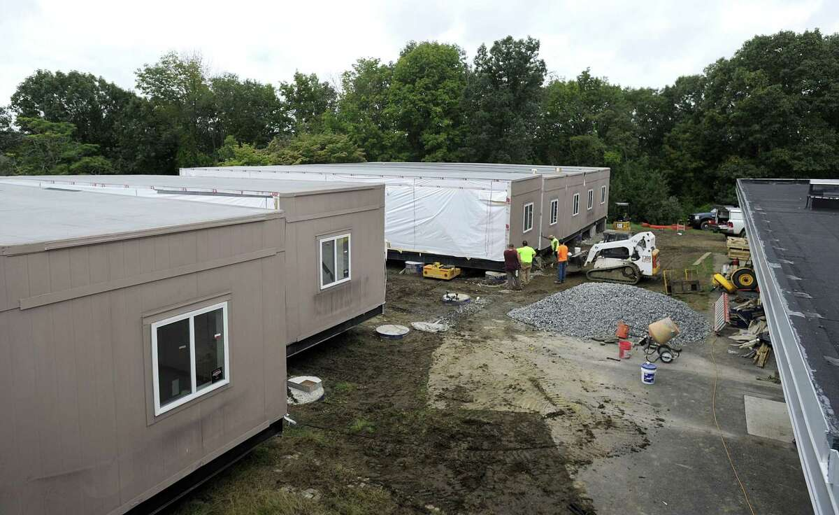 Crews are installing the new modular classroom additions for Westside Middle School Academy in Danbury, Friday, Sept. 21, 2018.