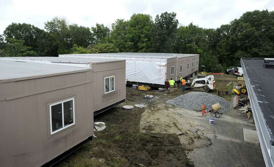 Crews are installing the new modular classroom additions for Westside Middle School Academy in Danbury, Friday, Sept. 21, 2018. Photo: Frank LaBanca / Hearst Connecticut Media / The News-Times