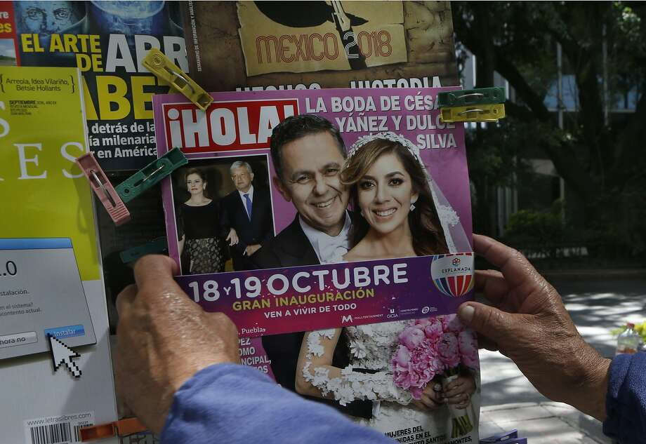 The cover of Hola! magazine features Cesar Yanez, a personal adviser to Mexican President-elect Andres Manuel Lopez Obrador, and his bride Dulce Maria Silva in Mexico City, Thursday, Oct. 4, 2018. The wedding, officiated by an archbishop, with designer dresses, palatial decorations and a huge convention-center reception, was likely the last image Mexico's austerity-minded president-elect wanted one of his closest advisers projecting, and it quickly drew criticism.  (AP Photo/Marco Ugarte) Photo: Marco Ugarte, Associated Press