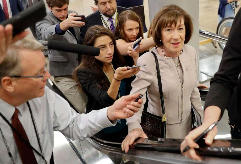 Sen. Susan Collins is mobbed by reporters before speaking out for Brett Kavanaugh. Photo: Pablo Martinez Monsivais / Associated Press