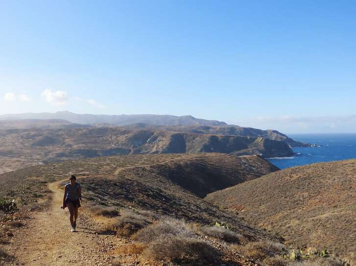 Hiker on a trail on Santa Catalina Island in Channel Islands National Park.