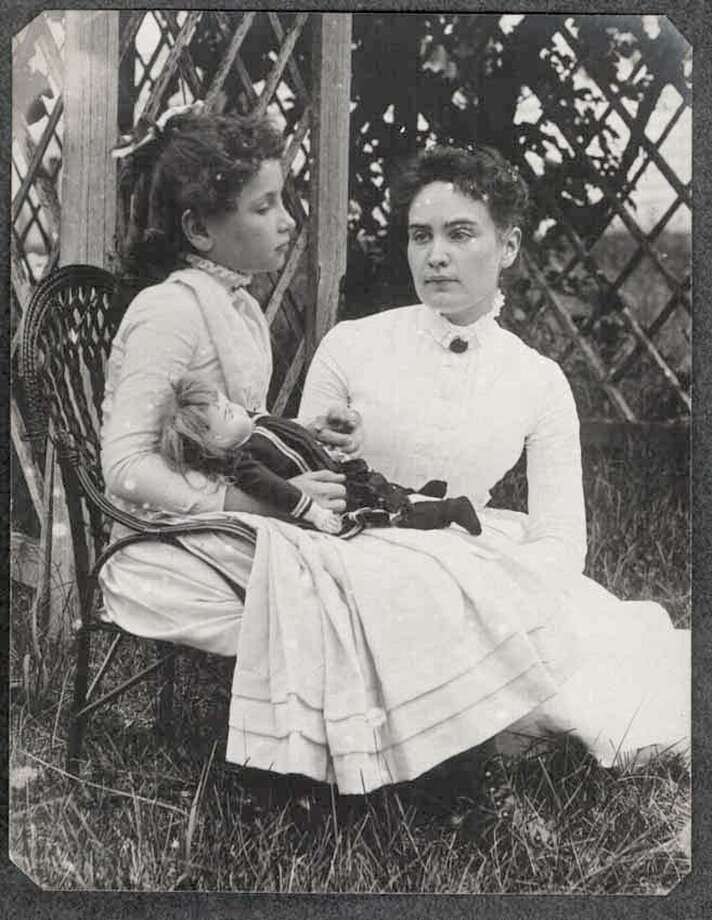 This 1888 photo released by the New England Historic Genealogical Society in Boston shows Helen Keller when she was eight years old, left, holding hands with her teacher, Anne Sullivan, during a summer vacation to Brewster, Mass., on Cape Cod. The State Board of Education will remove 40 minutes of teaching on Keller from Texas schools. Photo: /AP / New England Historic Genealogica