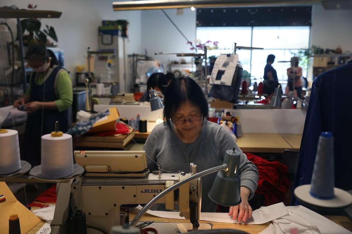 Lai Leung, seamstress, works at a sewing machine at Yorkland Productions at 150 Hooper on Friday, October 5, 2018 in San Francisco, Calif.