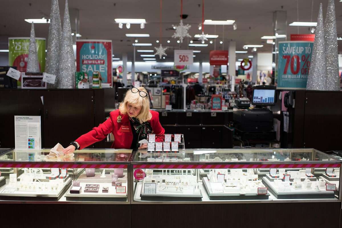 Barbara Cake, 67, cleans the jewelry counter towards the end of her shift at JC Penny on December 23, 2017 at the Shenango Valley Mall in Hermitage, Pennsylvania. Dustin Franz for The Washington Post via Getty Images