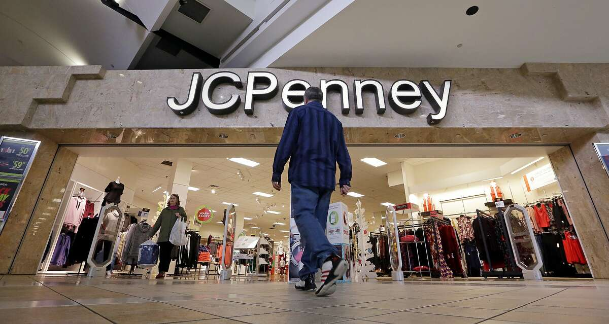 FILE- In this Nov. 24, 2017, file photo, a shopper heads into a J.C. Penney store in Seattle J.C. Penney Co. reports financial results on Friday, March 2, 2018. (AP Photo/Elaine Thompson, File)