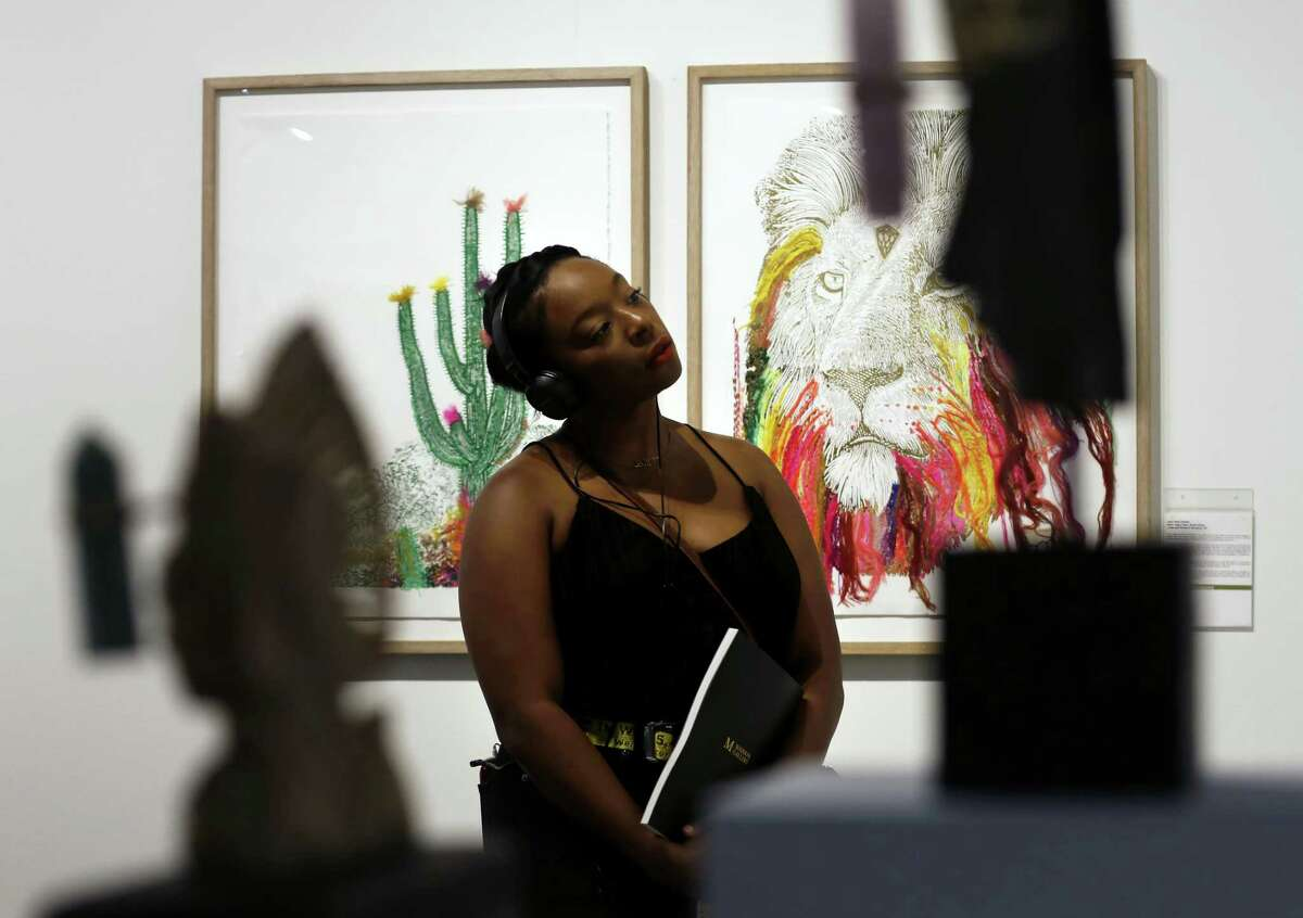 Brianna Mills studies art pieces displayed in the Aureus Contemporary space during the Texas Contemporary Art Fair at the George R. Brown Convention Center on Friday, Oct. 5, 2018, in downtown Houston.