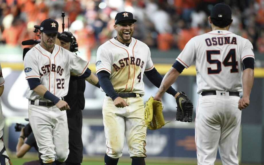 Houston Astros' Josh Reddick (22), George Springer (4) and Roberto Osuna (54) celebrate after the Astros' 7-2 win over the Cleveland Indians in Game 1 of a baseball American League Division Series, Friday in Houston. Photo: Eric Christian Smith, FRE / Associated Press / Copyright 2018 The Associated Press. All rights reserved