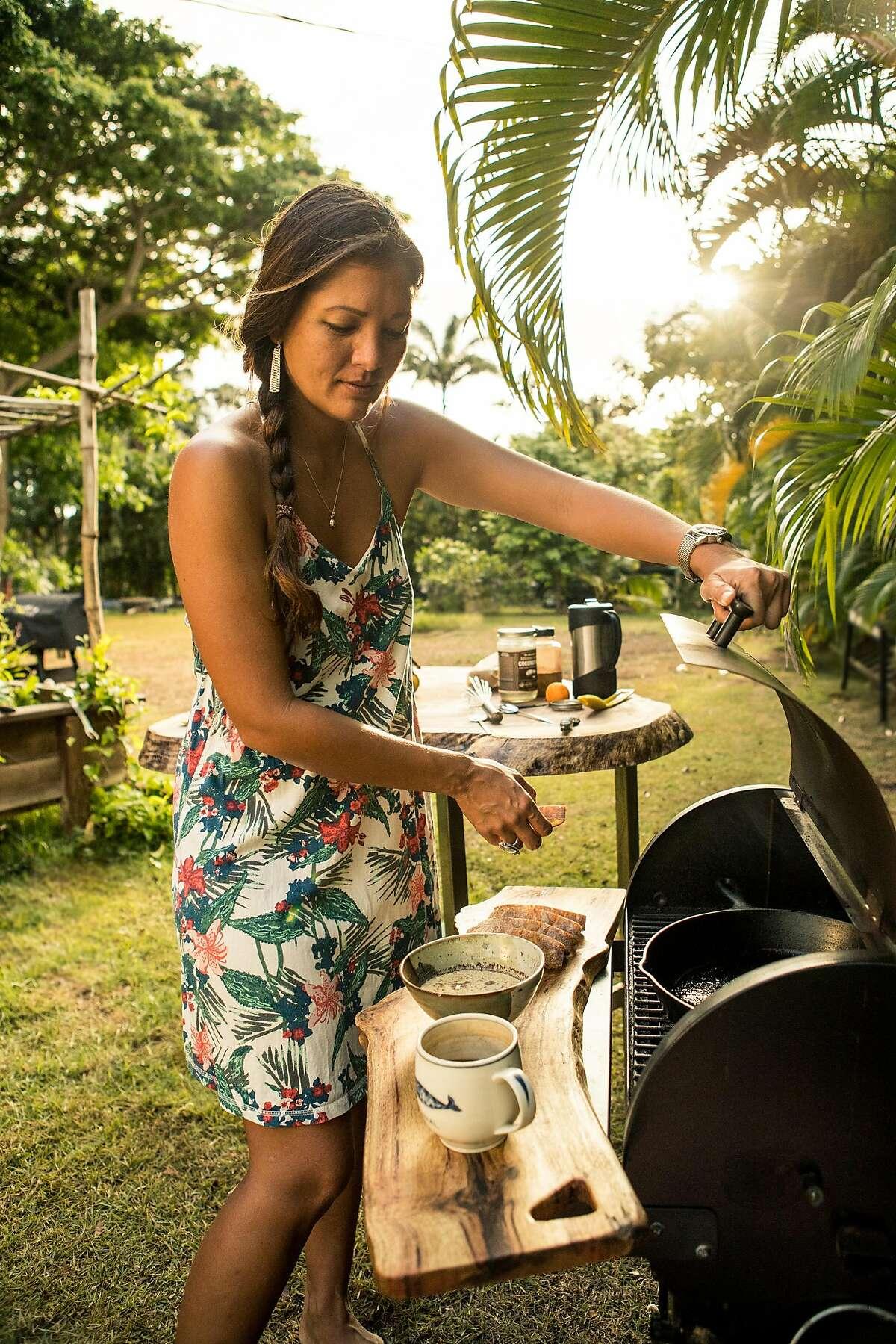 Kimi Werner prepares a meal on Friday, July 6, 2018 in Oahu, HI