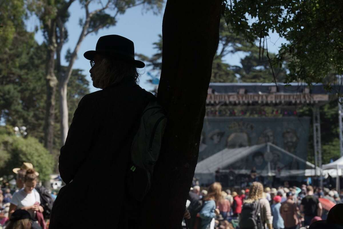 A man watches as the David Bromberg Quintet performs at Hardly Strictly Bluegrass in San Francisco. The lineup is headlined by Alison Krauss, Ani DiFranco, Jeff Tweedy, Emmylou Harris & the Red Dirt Boys, and Ween. The event is free to attend through Sunday in Golden Gate Park.