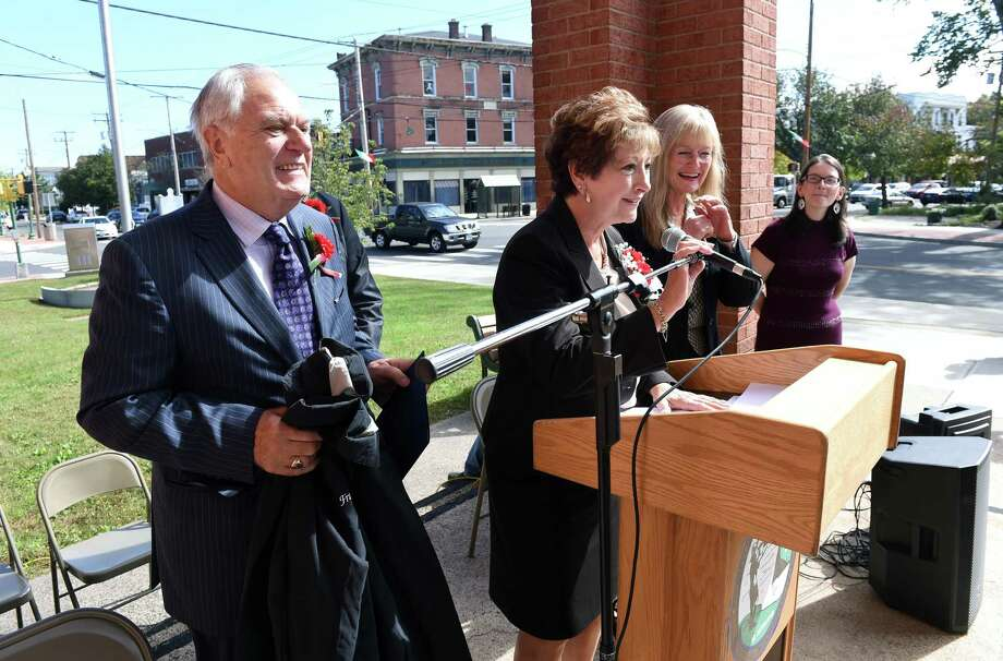 Mario Coppola (left) and his wife, Francine (center), were honored as the Italian-Americans of the Year at the 20th Annual Columbus Day Celebration in front of City Hall in West Haven on October 5, 2018. Photo: Arnold Gold / Hearst Connecticut Media / New Haven Register