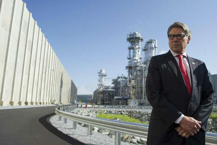 Secretary of Energy Rick Perry stands with the main cyrogenic heat exchange behind him as he speaks with reporters at Dominion Engery's Cove Point LNG liquefaction Project facility in Lusby, Md., Thursday, July 26, 2018. The completion of the facilities export expansion project makes it just the second LNG export facility in the U.S. (AP Photo/Cliff Owen)