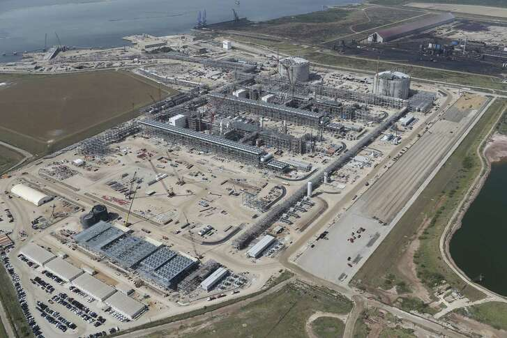 Construction continues at the Cheniere Liquid Natural Gas plant in Portland, Texas, Tuesday, Aug. 8, 2017. Stage one of the project broke ground on June 2015 and is scheduled to be in service in late 2018. The complete project will have a cost of over $20 billion. On the upper right corner is the Voestalpine plant that produces material for steel making.