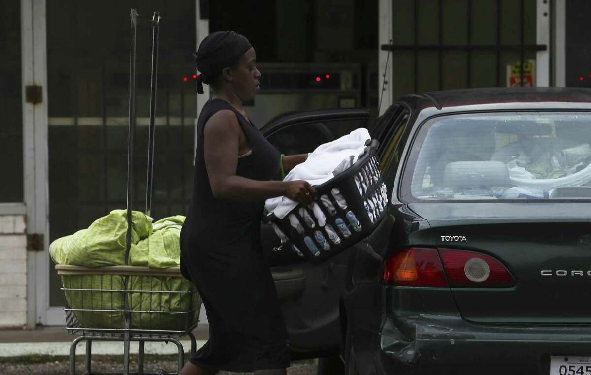 Ishmiya Morrison loads her clean laundry into her car at a washateria on Crane Street on Wednesday, Sept. 26, 2018, in northeast Houston. The washateria was the site of a 2016 shooting that police solved with the help of a federal ballistics database.