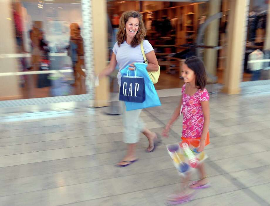 Eight-year-old Olivia Keator and her mother, Julie, enjoy a day of back-to-school shopping at the Connectuct Post mall in Milford. Photo: File Photo